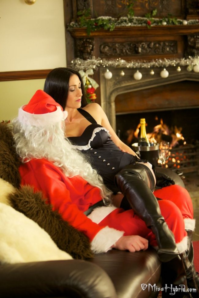 Leather boots stockings and gloves Miss Hybrid has a surprise for Santa.