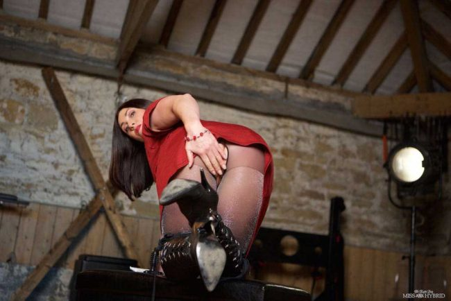 Easy access pantyhose leather boots and glazed tits, Miss Hybrid in the dungeon.